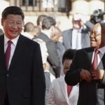 chinese-president-xi-jinping-walks-with-south-african-president-jacob-zuma-upon-his-arrival-at-the-union-buildings-in-pretoria